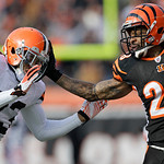 Cincinnati Bengals running back Bernard Scott (28) pushes off Cleveland Browns cornerback Joe Haden (23) in the first half of an NFL football game, Sunday, Dec. 19, 2010, in Cincinnati. (AP  …