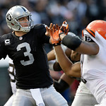 Oakland Raiders quarterback Carson Palmer (3) passes against the Cleveland Browns during the first half of an NFL football game in Oakland, Calif., Sunday, Dec. 2, 2012. (AP Photo/Marcio Jos …