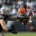 Cleveland Browns running back Trent Richardson (33) leaps in front of Oakland Raiders linebacker Miles Burris (56) during the third quarter of an NFL football game in Oakland, Calif., Sunday …