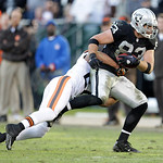 Oakland Raiders tight end Brandon Myers (83) runs against Cleveland Browns free safety Eric Hagg (27) during the second half of an NFL football game in Oakland, Calif., Sunday, Dec. 2, 2012. …