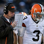 Cleveland Browns head coach Pat Shurmur, left, talks with quarterback Brandon Weeden (3) during the second half of an NFL football game against the Oakland Raiders in Oakland, Calif., Sunday …