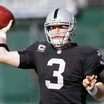 Oakland Raiders quarterback Carson Palmer (3) passes against the Cleveland Browns during the first quarter of an NFL football game in Oakland, Calif., Sunday, Dec. 2, 2012. (AP Photo/Tony Av …