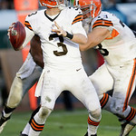 Cleveland Browns quarterback Brandon Weeden (3) against the Oakland Raiders during the second half of an NFL football game in Oakland, Calif., Sunday, Dec. 2, 2012. (AP Photo/Marcio Jose San …