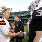Cleveland Browns quarterback Brandon Weeden, left, greets Oakland Raiders quarterback Carson Palmer after an NFL football game in Oakland, Calif., Sunday, Dec. 2, 2012. The Browns won 20-17. …