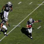 Oakland Raiders defensive back Matt Giordano (27) returns an interception from Cleveland Browns quarterback Brandon Weeden during the first quarter of an NFL football game in Oakland, Calif. …