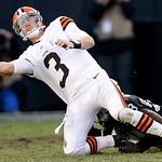 Oakland Raiders defensive end Lamarr Houston, rear, sacks Cleveland Browns quarterback Brandon Weeden (3) during the fourth quarter of an NFL football game in Oakland, Calif., Sunday, Dec. 2 …