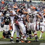 Cleveland Browns running back Trent Richardson (33) is congratulated by teammates after scoring on a 3-yard touchdown run against the Oakland Raiders during the fourth quarter of an NFL foot …
