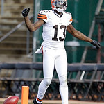 Cleveland Browns wide receiver Josh Gordon (13) celebrates after scoring on a 44-yard touchdown reception against the Oakland Raiders during the second quarter of an NFL football game in Oak …