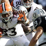 Cleveland Browns running back Trent Richardson (33) runs against Oakland Raiders defensive back Tyvon Branch (33) during the first quarter of an NFL football game in Oakland, Calif., Sunday, …