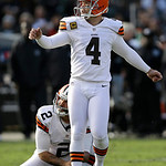 Cleveland Browns kicker Phil Dawson (4) kicks a 41-yard field goal from the hold of punter Reggie Hodges (2) second quarter of an NFL football game against the Oakland Raiders in Oakland, Ca …