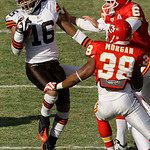 Cleveland Browns wide receiver Josh Cribbs (16) spins away from Kansas City Chiefs' Ryan Succop (6) and safety DaJuan Morgan (38) while returning a kickoff 100 yards for a touchdown during t …