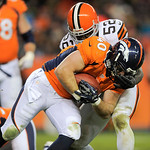 Denver Broncos running back Jacob Hester (40) is tackled by Cleveland Browns middle linebacker D'Qwell Jackson (52) in the fourth quarter of an NFL football game, Sunday, Dec. 23, 2012, in D …