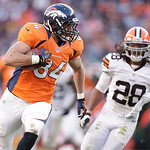 Denver Broncos tight end Jacob Tamme carries the ball after a reception during an NFL football game, Sunday, Dec. 23, 2012, in Denver. Cleveland Browns free safety Usama Young (28) chases af …