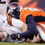 Cleveland Browns quarterback Brandon Weeden (3) is sacked by Denver Broncos defensive end Elvis Dumervil (92) in the third quarter of an NFL football game, Sunday, Dec. 23, 2012, in Denver.  …