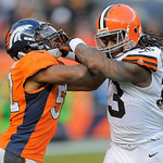 Cleveland Browns running back Trent Richardson, right, blocks Denver Broncos outside linebacker Wesley Woodyard during the fourth quarter of an NFL football game, Sunday, Dec. 23, 2012, in D …