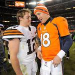 Denver Broncos quarterback Peyton Manning (18) talks with Cleveland Browns quarterback Colt McCoy (12) after playing in an NFL football game, Sunday, Dec. 23, 2012, in Denver. Denver won 34- …