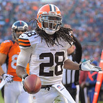 Cleveland Browns free safety Usama Young celebrates after picking off a Denver Broncos quarterback Peyton Manning pass in the second quarter an NFL football game, Sunday, Dec. 23, 2012, in D …