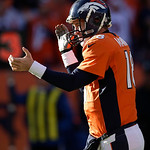 Denver Broncos quarterback Peyton Manning (18) reacts after throwing a touchdown pass against the Cleveland Browns in the first quarter of an NFL football game, Sunday, Dec. 23, 2012, in Den …