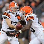 Cleveland Browns quarterback Colt McCoy (12) hands the ball off to running back Montario Hardesty (20) in the fourth quarter of an NFL football game against the Denver Broncos, Sunday, Dec.  …