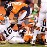 Cleveland Browns quarterback Colt McCoy (12) is sacked by Denver Broncos outside linebacker Wesley Woodyard (52) in the fourth quarter of an NFL football game, Sunday, Dec. 23, 2012, in Denv …