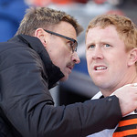 A Cleveland Browns trainer works on Cleveland Browns quarterback Brandon Weeden after he was injured in the fourth quarter of an NFL football game against the Denver Broncos, Sunday, Dec. 23 …