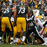 Side judge Rick Patterson (15) works to break up a scrum after the play between the Pittsburgh Steelers and Cleveland Browns during an NFL football game in Pittsburgh, Sunday, Dec. 30, 2012. …