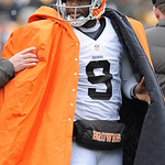 Cleveland Browns quarterback Thad Lewis wears the overcoat on the sideline in an NFL football game against the Pittsburgh Steelers on Sunday, Dec. 30, 2012, in Pittsburgh. (AP Photo/Don Wrig …