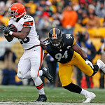 Cleveland Browns running back Montario Hardesty (20) gets past Pittsburgh Steelers inside linebacker Lawrence Timmons (94) for a six-yard gain during the second quarter of an NFL football ga …
