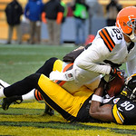 Cleveland Browns cornerback Joe Haden (23) lays on Pittsburgh Steelers wide receiver Plaxico Burress (80) after Buress made a touchdown catch in the fourth quarter of an NFL football game on …
