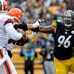 Pittsburgh Steelers defensive end Ziggy Hood (96) rushes Cleveland Browns quarterback Thad Lewis (9) during the first quarter of an NFL football game on Sunday, Dec. 30, 2012, in Pittsburgh. …