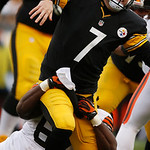 Pittsburgh Steelers quarterback Ben Roethlisberger (7) is hit from behind after getting off a pass by Cleveland Browns nose tackle Ishmaa'ily Kitchen (67) during the third quarter of an NFL  …