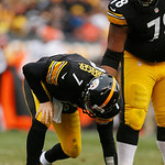 Pittsburgh Steelers quarterback Ben Roethlisberger (7) is helped up by Pittsburgh Steelers tackle Max Starks (78) after being hit from behind by Cleveland Browns nose tackle Ishmaa'ily Kitch …
