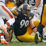 Pittsburgh Steelers defensive end Brett Keisel (99) holds his leg after being injured on a play late in the second quarter of an NFL football game against the Cleveland Browns in Pittsburgh, …