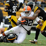 Pittsburgh Steelers strong safety Troy Polamalu (43) and free safety Ryan Clark (25) tackle Cleveland Browns tight end Benjamin Watson (82) during the second quarter of an NFL football game  …