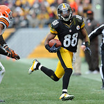 Cleveland Browns cornerback Trevin Wade (26) looks to tackle Pittsburgh Steelers wide receiver Emmanuel Sanders (88) during the third quarter of an NFL football game on Sunday, Dec. 30, 2012 …