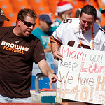 Cleveland Browns fans hold up a sign comparing Miami Heat player LeBron James and Cleveland Browns running back Peyton Hillis before an NFL football game between the Cleveland Browns and Mia …
