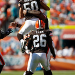 Cleveland Browns linebacker Eric Barton (50) jumps into the arms of defensive tackle Shaun Rogers, rear, after Rogers blocked a field goal attempt by Miami Dolphins kicker Dan Carpenter, not …