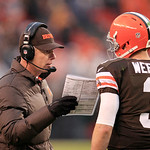 Cleveland Browns head coach Pat Shurmur, left, talks with Brandon Weeden during an NFL football game against the Kansas City Chiefs Sunday, Dec. 9, 2012, in Cleveland. (AP Photo/Tony Dejak)