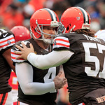 Cleveland Browns place kicker Phil Dawson (4) is congratulated by long snapper Christian Yount (57) after a 23-yard field goal against the Kansas City Chiefs in the first quarter of an NFL f …