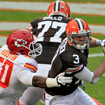 Cleveland Browns quarterback Brandon Weeden (3) tries to escape the rush from Kansas City Chiefs linebacker Justin Houston (50) in the second quarter of an NFL football game Sunday, Dec. 9,  …