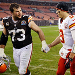 Cleveland Browns offensive tackle Joe Thomas (73) shakes hands with Kansas City Chiefs quarterback Brady Quinn after the Browns' 30-7 win in an NFL football game, Sunday, Dec. 9, 2012, in Cl …