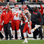 Kansas City Chiefs running back Jamaal Charles races past a cheering Chiefs' bench on an 80-yard touchdown run in the first quarter of an NFL football game against the Cleveland Browns Sunda …