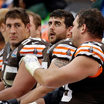 Cleveland Browns offensive tackle Joe Thomas, right, talks with line mates center Alex Mack, left, and guard John Greco on the bench in the third quarter of an NFL football game against the  …