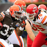 Cleveland Browns running back Trent Richardson (33) runs against Kansas City Chiefs defensive end Ropati Pitoitua (75) in the first half of an NFL football game Sunday, Dec. 9, 2012, in Clev …