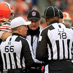 head linesman Steve Stelljes, center, huddles with referee Walt Anderson (66) and line judge Byron Boston (18) on a call in the first quarter of an NFL football game between the Kansas City  …