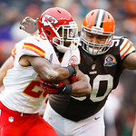 Kansas City Chiefs running back Shaun Draughn (20) runs the ball as Cleveland Browns defensive tackle Billy Winn (90) defends during an NFL football game in Cleveland, Sunday, Dec. 9, 2012.  …