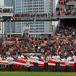 Select fans hold a large American flag for the playing of the national anthem before an NFL football game between the Kansas City Chiefs and Cleveland Browns Sunday, Dec. 9, 2012, in Clevela …