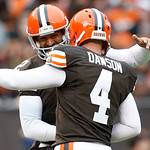 Cleveland Browns kicker Phil Dawson (4) receives congratulations from Reggie Hodges (2) after he kicks his 300th career field goal in the first quarter of an NFL football game against the Ka …