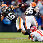 Cleveland Browns' Josh Cribbs (16) is tripped up by Kansas City Chiefs' Josh Bellamy on a fourth-quarter punt return in an NFL football game in Cleveland, Sunday, Dec. 9, 2012. The Browns wo …