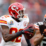 Kansas City Chiefs wide receiver Dwayne Bowe runs with a pass against Cleveland Browns cornerback Joe Haden (23) in the first quarter of an NFL football game in Cleveland, Sunday, Dec. 9, 20 …